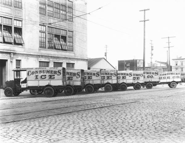 1915 Photograph - Eight Parked Ice Trucks by Underwood Archives