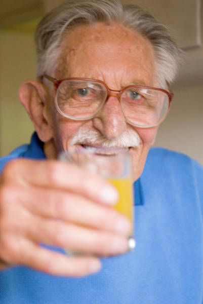 Wall Art - Photograph - Elderly Man Holding A Glass Of Juice by Mary Dunkin/science Photo Library
