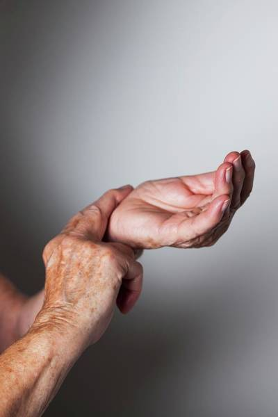 Pulse Photograph - Elderly Woman Monitoring Her Wrist Pulse by Cristina Pedrazzini/science Photo Library
