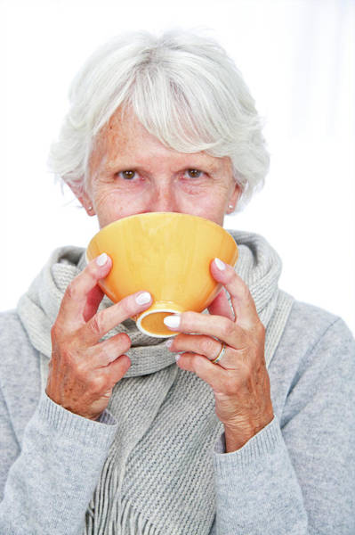 Warming Up Wall Art - Photograph - Elderly Woman With A Hot Drink by Lea Paterson