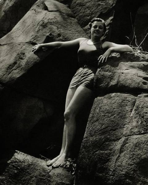 Swimming Photograph - Eleanor Holm Posing Amongst Large Rocks by Anton Bruehl
