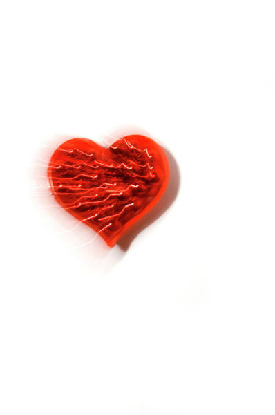 Emotion Photograph - Electric Red Heart On A White Background by Daryl Solomon