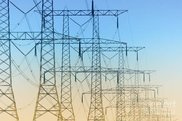 Electricity Pylons Standing In A Row Art Print