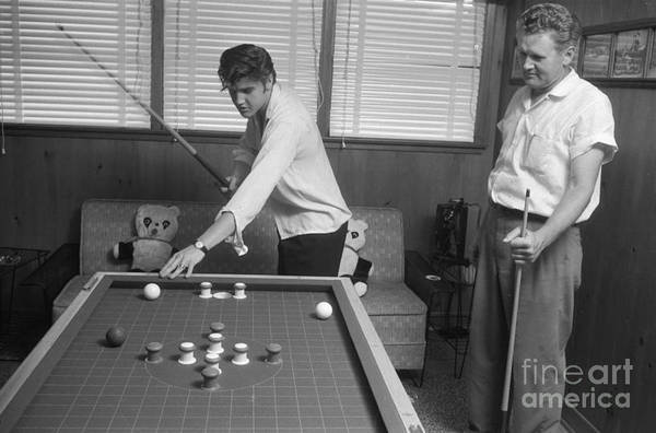 Wall Art - Photograph - Elvis Presley And Vernon Playing Bumper Pool 1956 by The Harrington Collection
