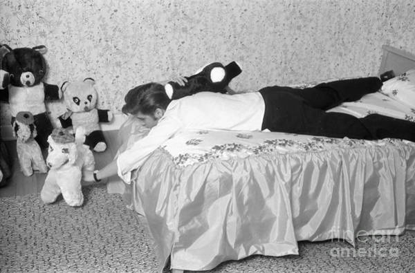 Wall Art - Photograph - Elvis Presley At Home With His Teddy Bears 1956 by The Harrington Collection