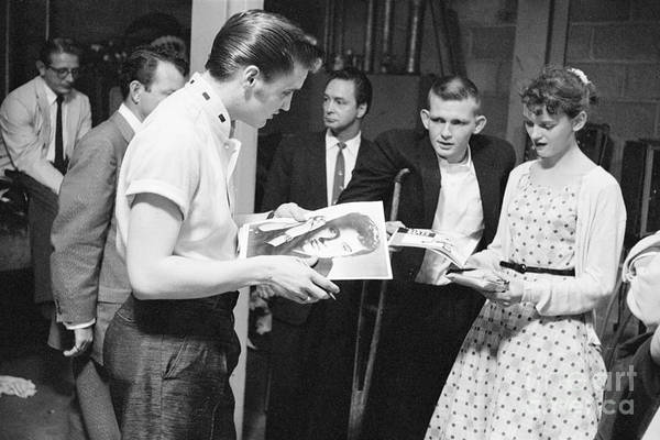 Wall Art - Photograph - Elvis Presley Backstage Signing Autographs For Fans 1956 by The Harrington Collection