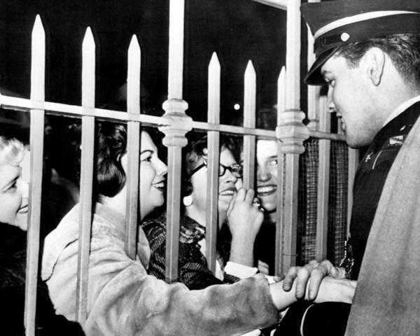 Controversy Photograph - Elvis Presley Embraces Fans by Retro Images Archive