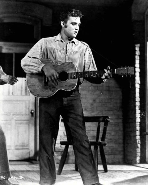 Controversy Photograph - Elvis Presley Playing Outside  by Retro Images Archive