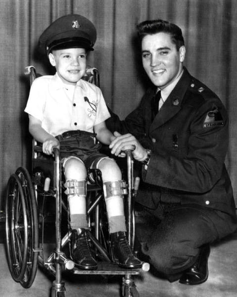 Controversy Photograph - Elvis Presley Takes Time With Boy by Retro Images Archive