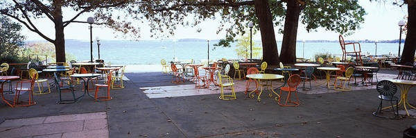 Lamppost Photograph - Empty Chairs With Tables In A Campus by Panoramic Images
