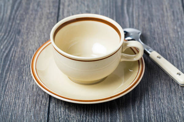 Wall Art - Photograph - Empty Coffee Cup And Saucer by Wladimir Bulgar/science Photo Library