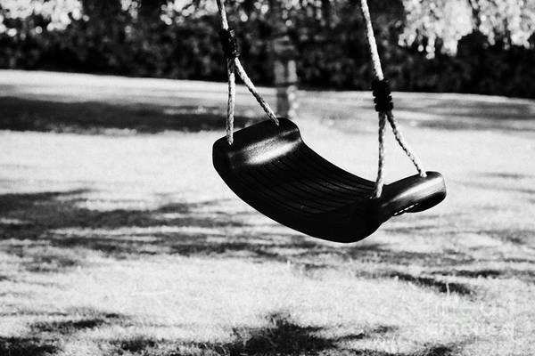 Wall Art - Photograph - Empty Plastic Swing Swinging In A Garden In The Evening by Joe Fox