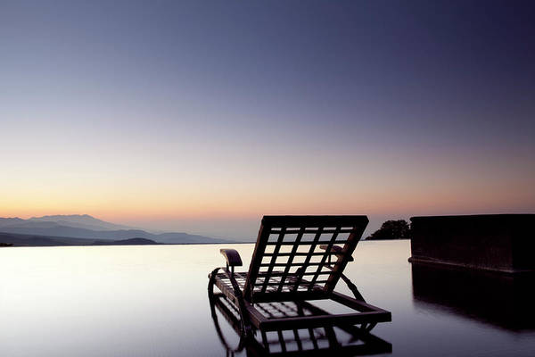 Wall Art - Photograph - Empty Seat On An Infinity Pool Facing by Marcaux