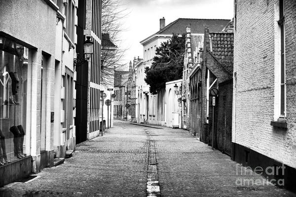 In Bruges Photograph - Empty Street In Bruges by John Rizzuto