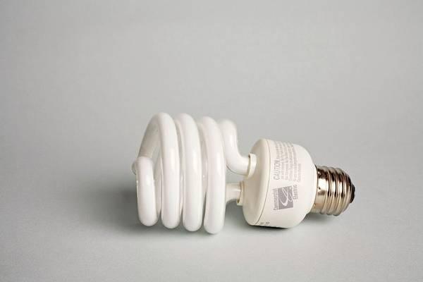 Energy-saving Wall Art - Photograph - Energy Efficient Light Bulb by Jim West