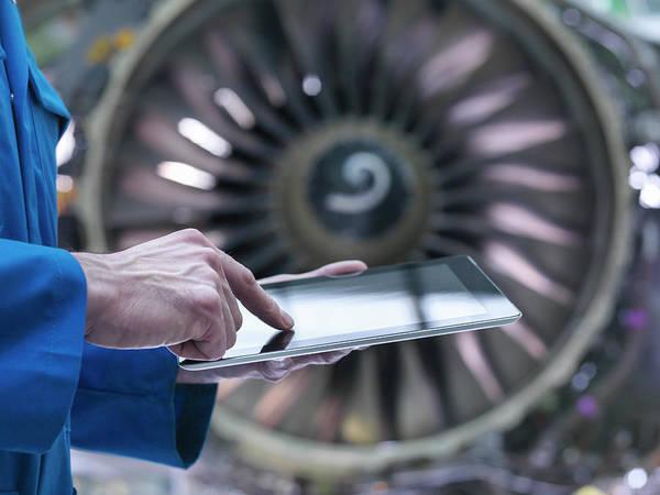 Manual Focus Wall Art - Photograph - Engineer Using Digital Tablet In Front by Monty Rakusen
