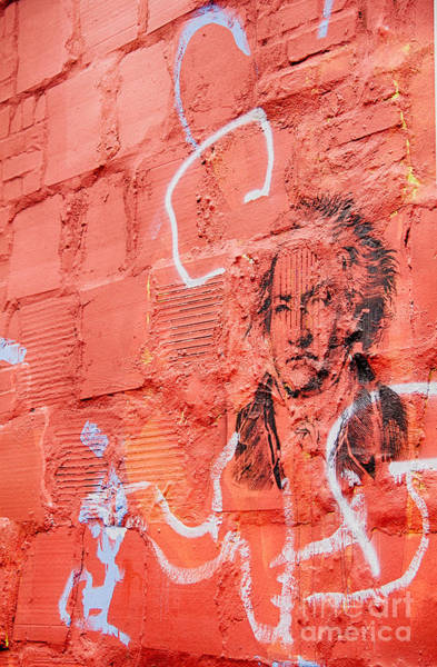 Photograph - Etched Man On A Red Brick Wall by Jim Lepard