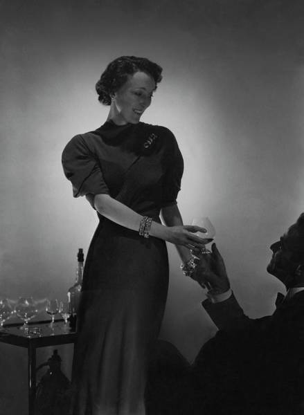 Alcoholic Drink Photograph - Evelyne Greig Modeling A Dress by Horst P. Horst