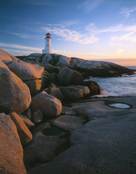 Peggys Cove Photograph - Evening Light On Peggys Cove Lighthouse by Panoramic Images
