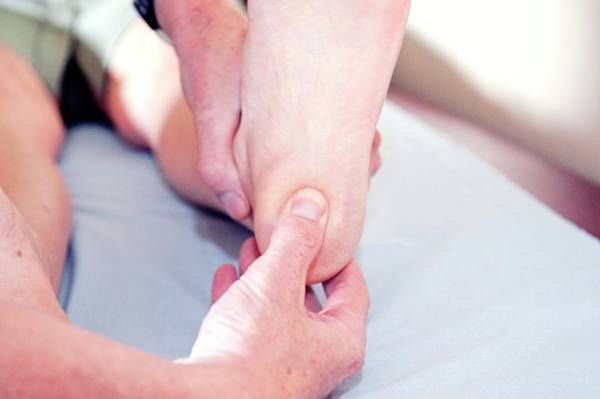 Examine Photograph - Examination Of Heel For Plantar Fasciitis by Dr P. Marazzi/science Photo Library