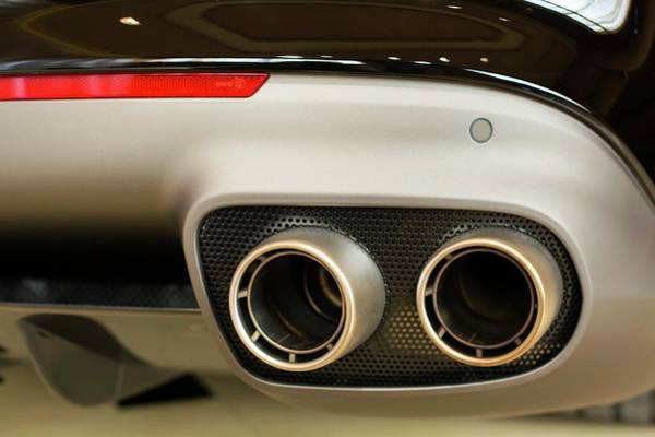 Auto Show Photograph - Exhaust Pipes Of A Ferrari California by Jim West