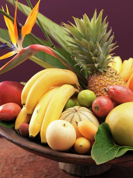 Wall Art - Photograph - Exotic Fruit Still Life In Wooden Bowl (close-up) by Foodcollection