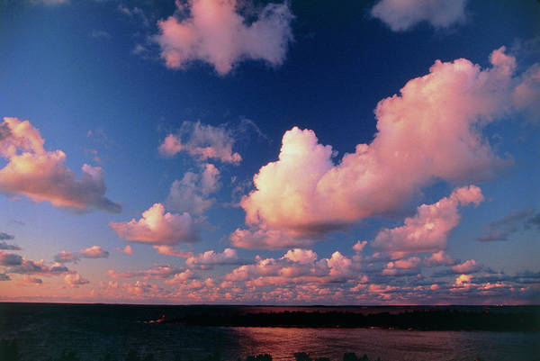 Cumulus Photograph - Fair-weather Cumulus Clouds Over Water At Sunset by Pekka Parviainen/science Photo Library