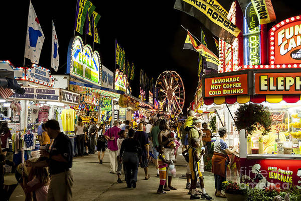 Photograph - Fairgoers Walk The Midway At Night At A County Fair by William Kuta
