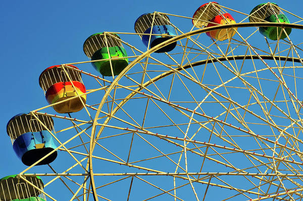 Bertrand Photograph - Fairground Ferris Wheel Against Blue Sky by Jade And Bertrand Maitre