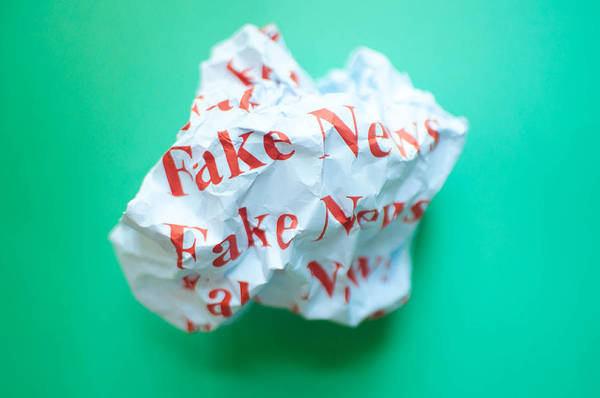 Fake News Against Blue Green Background Art Print by Karl Tapales
