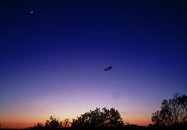 Fake Photograph - Fake Ufo Flying At Dusk Near Roswell by Peter Menzel/science Photo Library