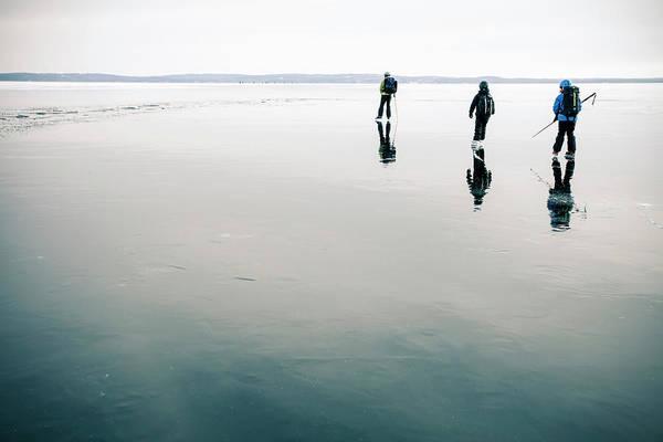Family Skiing On Frozen Lake Art Print