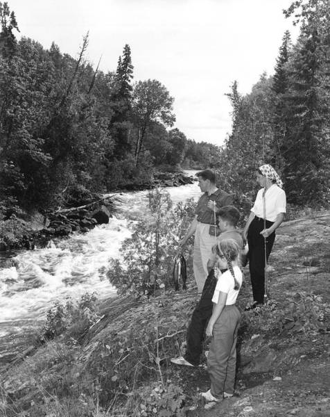 Trout Stream Photograph - Family Trout Fishing by Underwood Archives