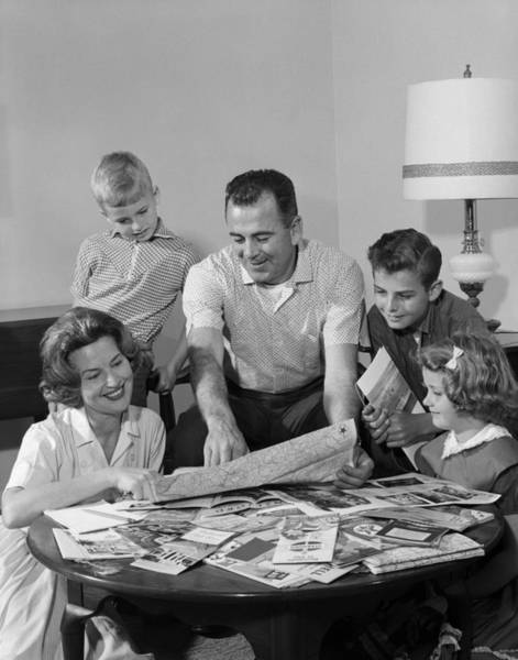 Road Map Photograph - Family With Maps Planning Vacation by H. Armstrong Roberts/ClassicStock