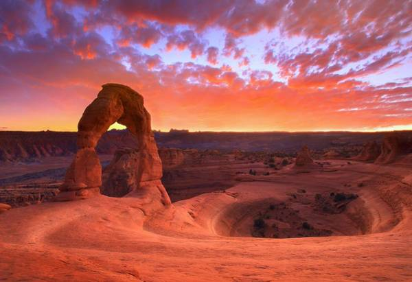 Delicate Arch Wall Art - Photograph - Famous Sunset by Kadek Susanto
