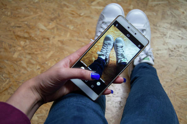 Smartphone Photograph - Fashion And Social Media by Stg/reporters/science Photo Library
