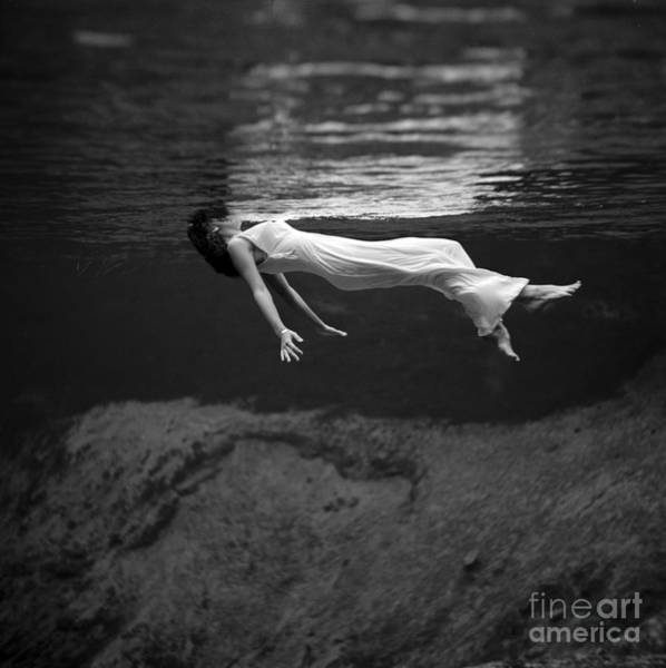Photograph - Fashion Model Floating In Water, 1947 by Science Source