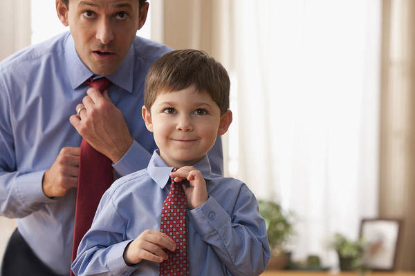 Father And Son Fixing Ties Together Art Print by SelectStock