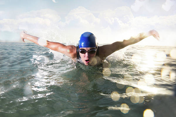 Endurance Race Photograph - Female Butterfly Stroke Swimmer by Amr Image