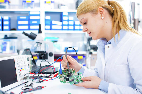 Scientist Photograph - Female Engineer Soldering A Circuit Board by Wladimir Bulgar/science Photo Library