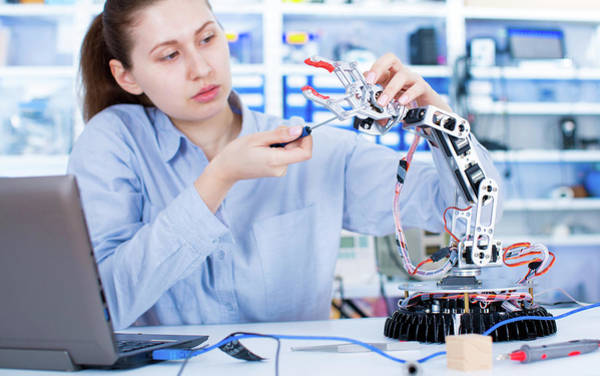 Wall Art - Photograph - Female Engineer Working In A Robotics Laboratory by Wladimir Bulgar/science Photo Library