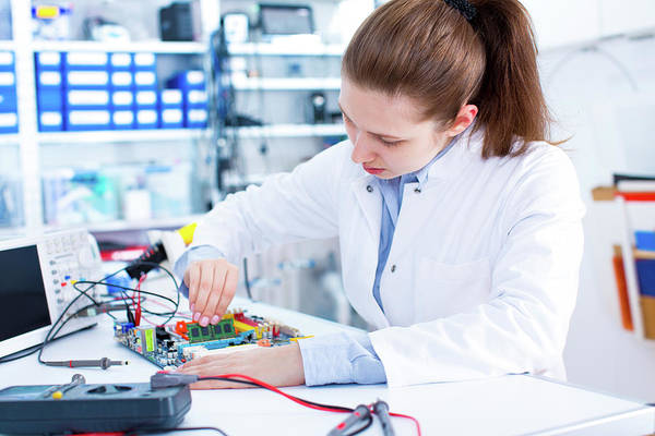 Scientist Photograph - Female Engineer Working On A Circuit Board by Wladimir Bulgar/science Photo Library
