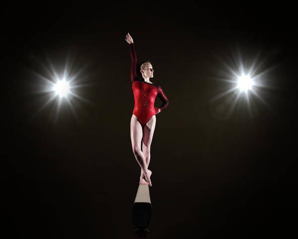 Hip Photograph - Female Gymnast On Balancing Beam by Mike Harrington