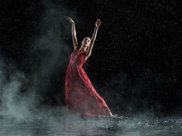 Red Dress Photograph - Female In Red Dancing, Rainy And Misty by Jonathan Knowles