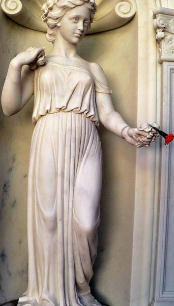 Photograph - Female Statue With Red Flower by Jeff Lowe