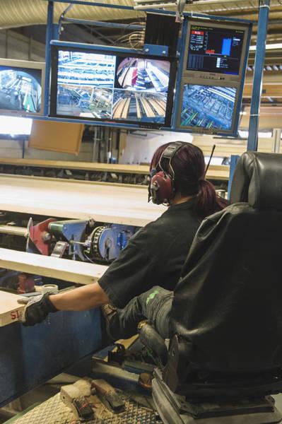 Female Worker Monitoring Computer Screens At Lumber Industry Art Print by Hakan Jansson