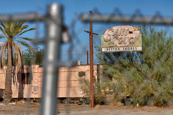 Photograph - Fenced In  Abandoned 1950's Motel Trailer by Scott Campbell