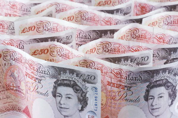 Economics Photograph - Fifty Pound Notes by Paul Rapson/science Photo Library