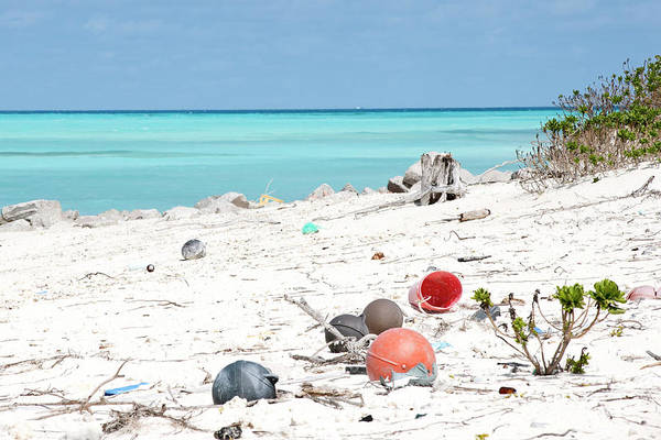 Atoll Photograph - Fifty Tons Of Plastic Arrive At Midway by Daisy Gilardini