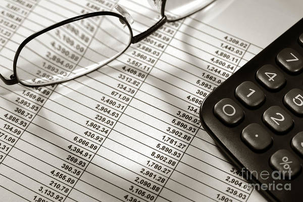 Wall Art - Photograph - Financial Spreadsheet With Calculator And Glasses by Olivier Le Queinec